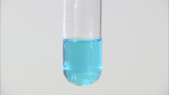 Copper (II) hydroxide precipitate, formed as sodium hydroxide is dripped into copper (II) sulphate solution