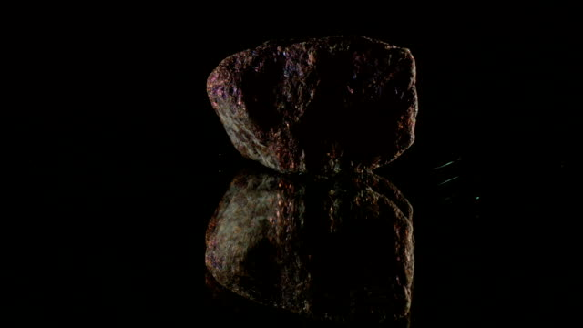 Copper ore on black