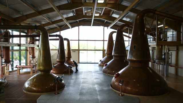 a copper pot still used to distill the glenlivet single malt whisky produced by pernod ricard sa at the companys distillery in ballindalloch uk on... - scotch whiskey stock videos and b-roll footage