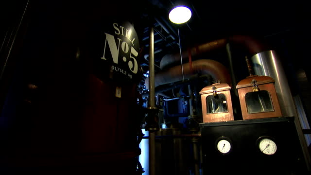 copper stills operate in a corn alcohol processing plant. - distillery still stock videos & royalty-free footage
