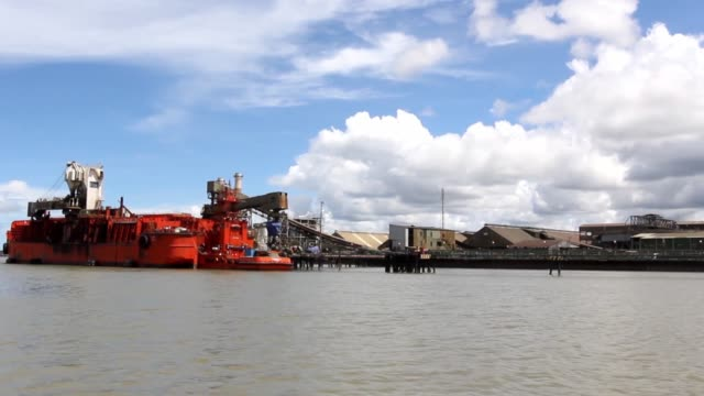 coppergold concentrate from freeport mcmoran inc's grasberg copper and gold mine is loaded onto a ship at the company's loading facility in the port... - copper mine stock videos and b-roll footage
