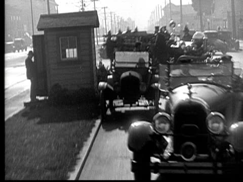 ms, b&w, cops car and  fire engine driving fast on street, 1930's  - 無声映画点の映像素材/bロール