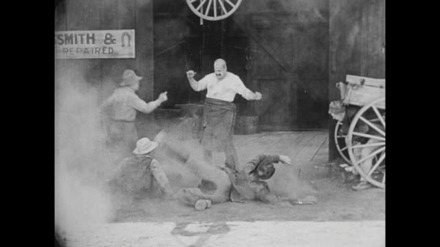 1922 Cops stick up for little guy (Buster Keaton) against big bully (Joe Roberts)