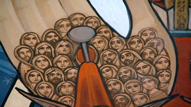 stockvideo's en b-roll-footage met coptic religious icons view of the crucified right palm of jesus christ the palm is painted with the worshipful faces of christ's followers - gelovige