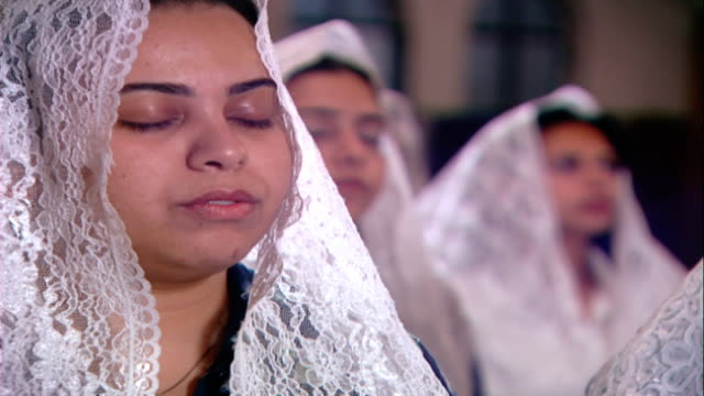 copts mcu on female worshippers wearing lace head scarves reciting prayers in unison copts make up 1015 percent of egyptians - eyes closed stock videos & royalty-free footage