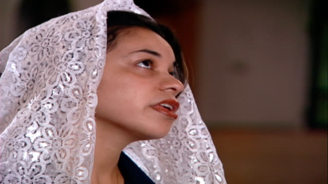 copts cu on a female coptic worshipper reciting prayers in church her head covered in a lace scarf copts make up 1015 percent of egyptians - worshipper stock videos & royalty-free footage