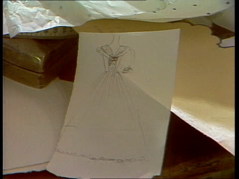 copy cat dress; england: east london: ellis bridals rosie joseph sketches from tv monitor cms sketch pull cms seamstress at work zoom dress on model... - zoom out点の映像素材/bロール