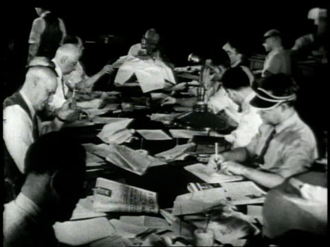 1948 montage copy readers editing news reports / new york city, new york, united states - ニューヨークタイムズ点の映像素材/bロール