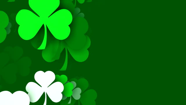 copy space, shamrocks zooming by, for saint patrick's day (loopable) - st. patrick's day stock videos and b-roll footage