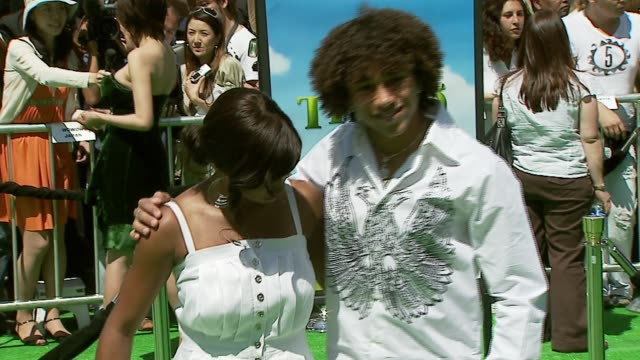 corbin bleu and monique coleman at the 'shrek the third' premiere at the mann village theatre in westwood, california on may 6, 2007. - monique coleman stock videos & royalty-free footage
