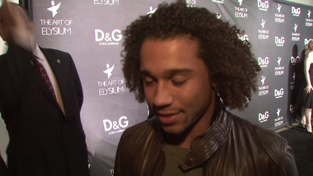 corbin bleu on why she loves dolce & gabbana, on what she's wearing, on the art of elysium, on what she wants for christmas, and on her plans for new... - dolce & gabbana点の映像素材/bロール