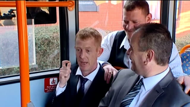 corby bus drivers win euromillions lottery england northamptonshire corby ext gvs bus drivers' syndicate posing for photocall as one uncorks bottle... - john noakes stock videos and b-roll footage