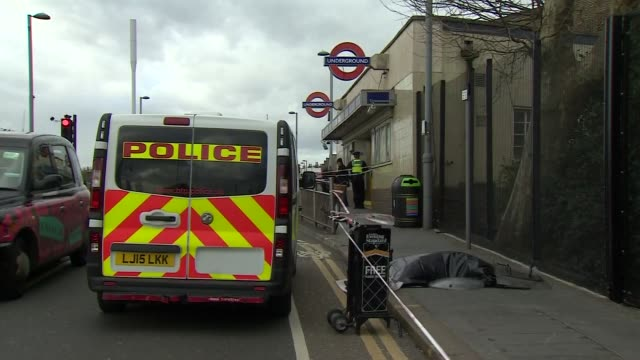 a cordoned off crime scene after a stabbing in leyton - stechen stock-videos und b-roll-filmmaterial
