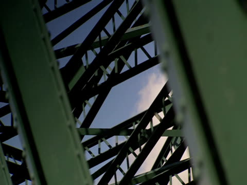 cords criss-cross between girders on a bridge. - crisscross stock videos & royalty-free footage