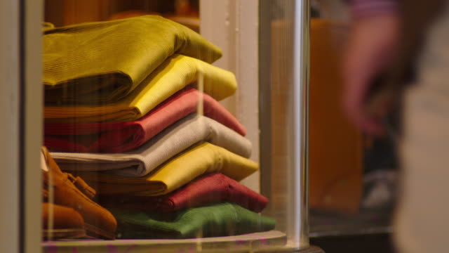 corduroy trousers form part of a window display at a central london boutique tailors', uk. - boutique stock videos and b-roll footage