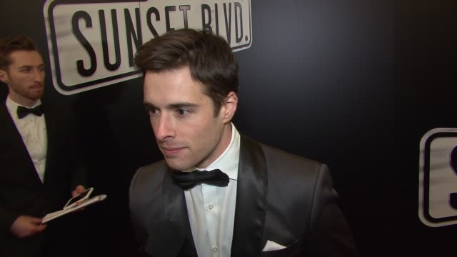 """vídeos de stock e filmes b-roll de corey cott talks about getting to see glenn close perform live at """"sunset boulevard"""" opening night at palace theatre on february 09, 2017 in new york... - glenn close"""