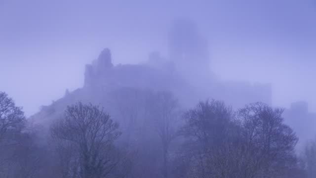 corfe castle in dorset shrouded in mist. - castle stock videos & royalty-free footage