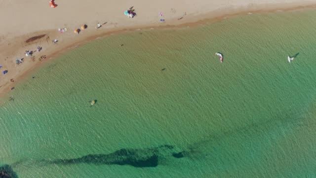 corfu, kekyra, aerial drone footage of majestic halikounas, chalikounas beach at summer - majestic stock videos & royalty-free footage