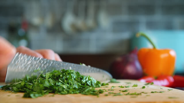 coriander is finely chopped with a knife - preparing food stock videos & royalty-free footage