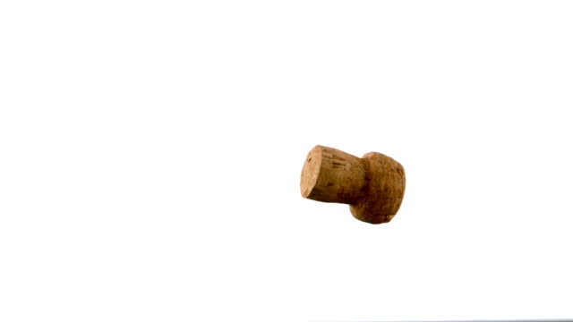 cork from champagne falling and dropping - sektkorken stock-videos und b-roll-filmmaterial