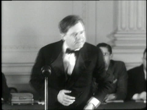 a cork pops from a bottle of champagne during us senator huey long's share our wealth speech - 1930 stock-videos und b-roll-filmmaterial