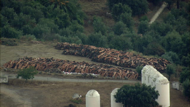 aerial ws cork stacked outside farm house / evora, portugal - cork material stock videos & royalty-free footage