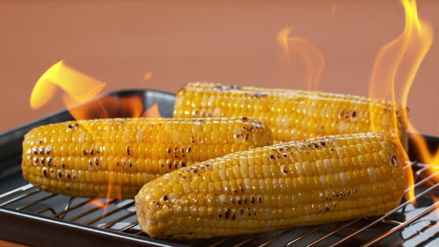 corn being roasted with fire - burnt stock videos & royalty-free footage