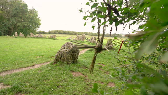 a corn dolly blowing in the wind at the rollright stones. - obelisk stock videos & royalty-free footage