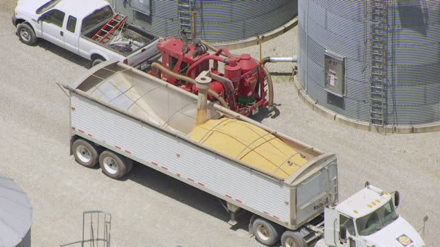 WS AERIAL POV Corn kernels being loading into truck / Grant County, Indiana, United States
