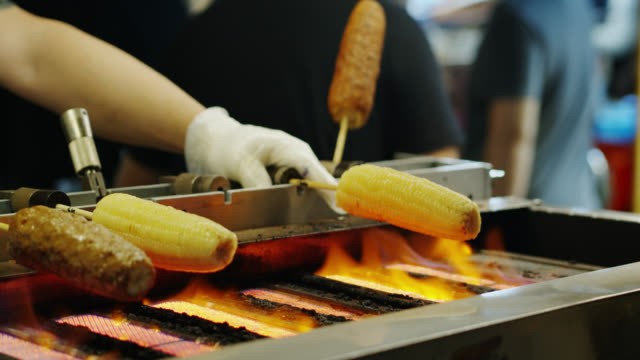 corn on the cob being grilled at raohe night market - taipei stock videos & royalty-free footage