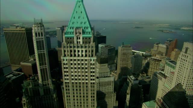 a cornea of light shines above the trump building. - cornea stock videos & royalty-free footage