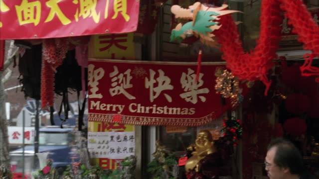 ms pan  corner of  asian market with christmas decorations / new york, new york, united states - asian market stock videos and b-roll footage