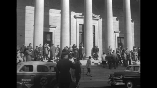 corner of constitution hall bus passes in front / front of hall people standing at entrance and on sidewalk cars at curb / cu top of hall above... - constitution stock videos and b-roll footage