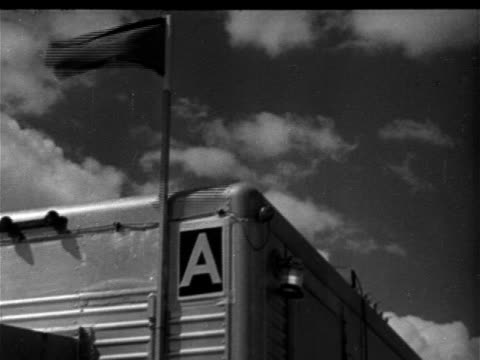 vidéos et rushes de corner of mobile structure possibly trailer w/ dark flag flying on pole amp letter 'a' on end ms signs 'secrecy the word to remember' 'us atomic... - 1952