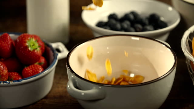 cornflakes falling into bowl - low carb diet stock videos & royalty-free footage
