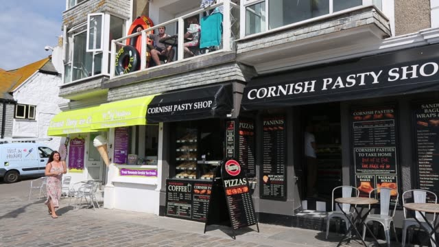 a cornish ice cream and cornish pasty shops in st ives cornwall uk - unhealthy eating stock videos & royalty-free footage