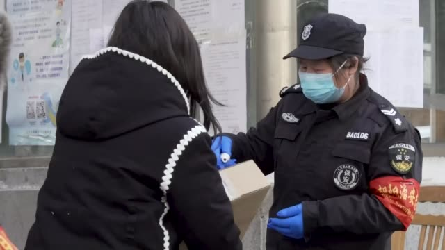 concern about number of people who have 'disappeared' during outbreak; china: car drivers and pedestrians in beijing have their temperatures tested... - customs stock videos & royalty-free footage