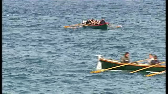 shot as along at sea off the cornish coast to cox shouting instructions sot sequence of high angle shots and shots of pilot gigs rowed along offshore... - top of the pops stock videos & royalty-free footage