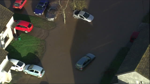 air views; air view of flooded residential area, including flooded football pitch, partly submerged cars outside houses, flood water surrounding... - surrounding stock videos & royalty-free footage