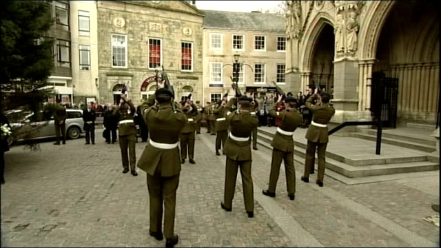 truro ext guard of honour fire rifles in military salute outside cathedral military pallbearers loading flagdraped coffin into hearse widow christina... - saluting stock videos & royalty-free footage