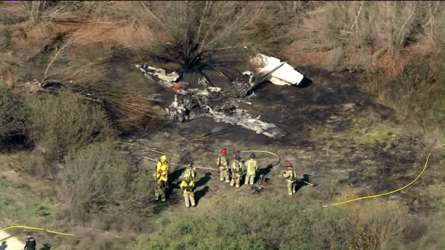 corona, ca, us - crash site of a plane that went down right after taking off from corona municipal airport, where four people died, on wednesday,... - 航空事故点の映像素材/bロール