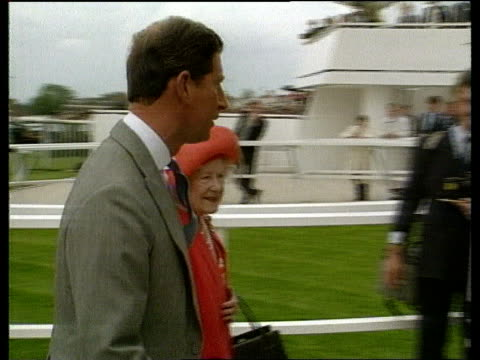 stockvideo's en b-roll-footage met coronation anniversary/ the queen at the derby england surrey epsom gv epsom stands ms queen along and past followed by prince charles and queen... - omsloten ruimte