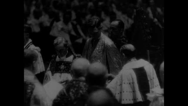 vs coronation ceremony in westminster abbey / king george vi wearing supertunica sitting in king edward's chair flanked on either side by archbishops... - coronation stock videos and b-roll footage