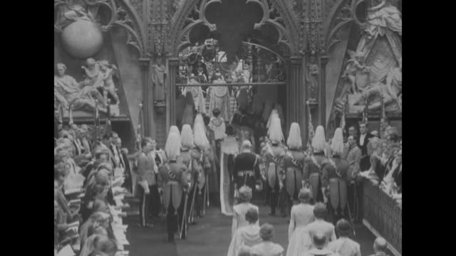 coronation guests stand / elizabeth ii wearing the diamond diadem and robe of estate with maids of honor and other attendants walk down aisle in... - princess elizabeth stock videos and b-roll footage