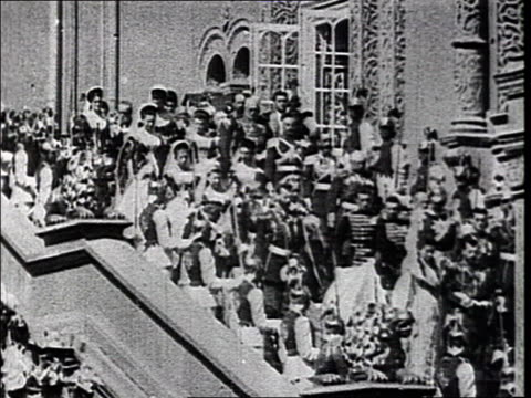 coronation of czar nicholas ii in moscow carriage passing by camera horseguards and soldiers escorting carriages nicholas ii and wife alexandra... - coronation stock videos and b-roll footage