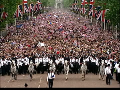 coronation party preparations lib mass crowds lining the mall during golden jubilee celebrations tgv police and mounted police towards along mall... - golden jubilee stock videos & royalty-free footage