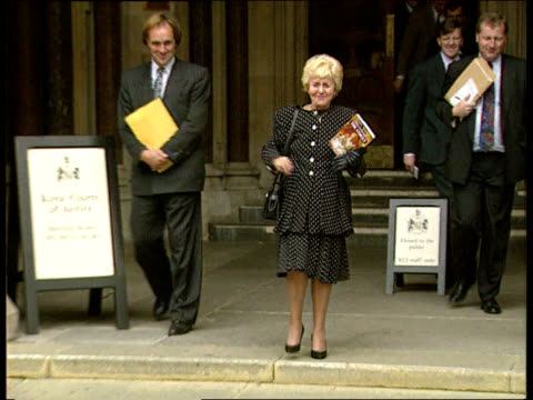 """""""coronation street"""" actress settles court case over autobiograhy; lynne perrie out of court waving her autobiograpy """"secrets of the street"""" as down... - seifenoper stock-videos und b-roll-filmmaterial"""