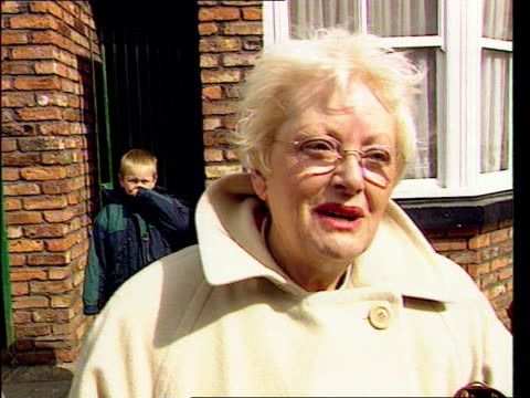 Dierdre let out of jail ITN GV tourists about in street Tourists outside 'Rovers Return' Tourists outside Corner Shop Vox pops tourists Jenny Eden...