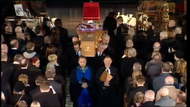 coronation street stars attend bill tarmey's funeral; int high angle view pallbearers carrying coffin down aisle high angle view coronation street... - soap opera stock videos & royalty-free footage