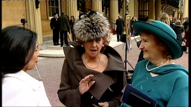 coronation street stars receive mbes england london ext barbara knox and eileen derbyshire towards barbara knox and eileen derbyshire interview sot... - anniversary stock videos & royalty-free footage